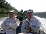 Kawahara and colleagues traveling by pirogue in Amazon