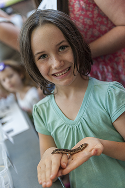 Buterflyfest girl holding caterpillar
