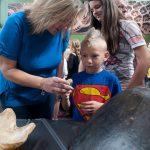 Visitors with turtles, half head