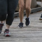 people running on boardwalk