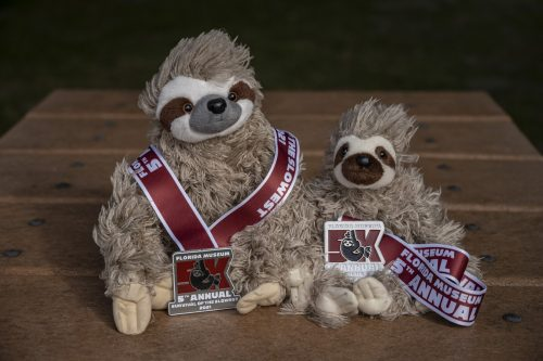 sloth doll with medals