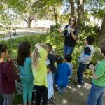 Children learn to use an atlatl during Spring Break Camp 2013.