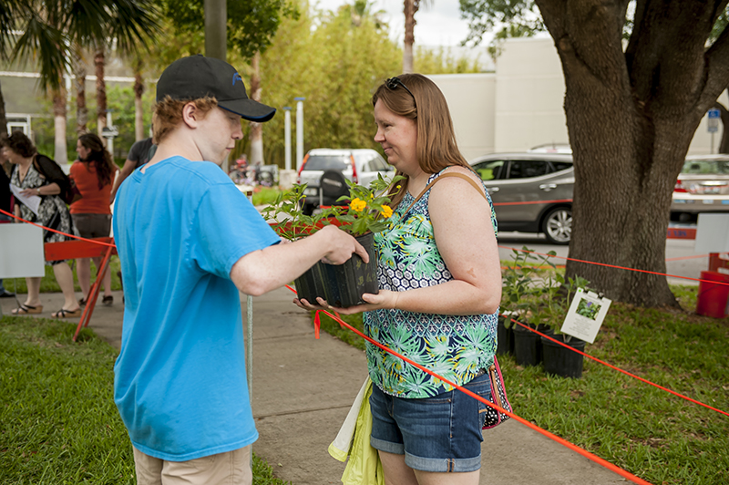 Junior Volunteers can help with customers during the Spring Plant Sale.