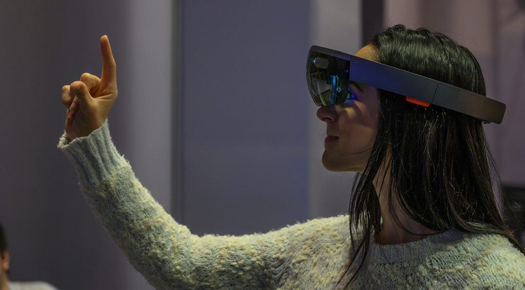 woman using virtual reality software and pointing