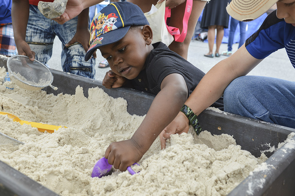 Child digging in sand