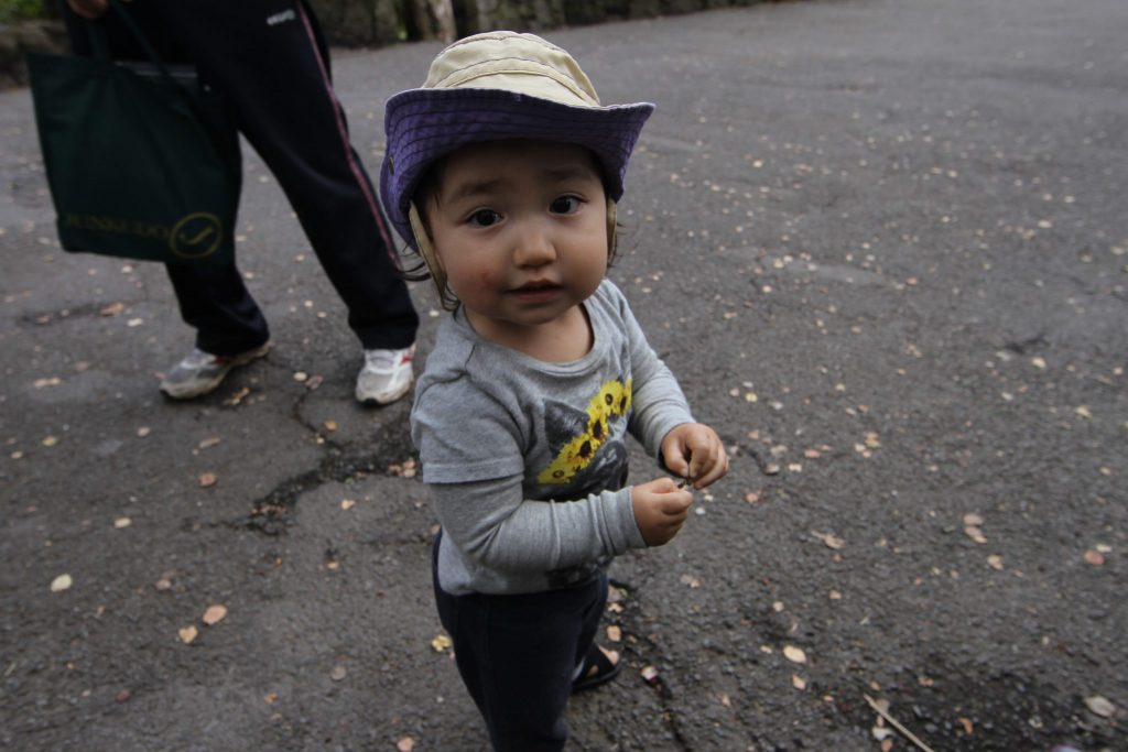 toddler smiling for a photograph
