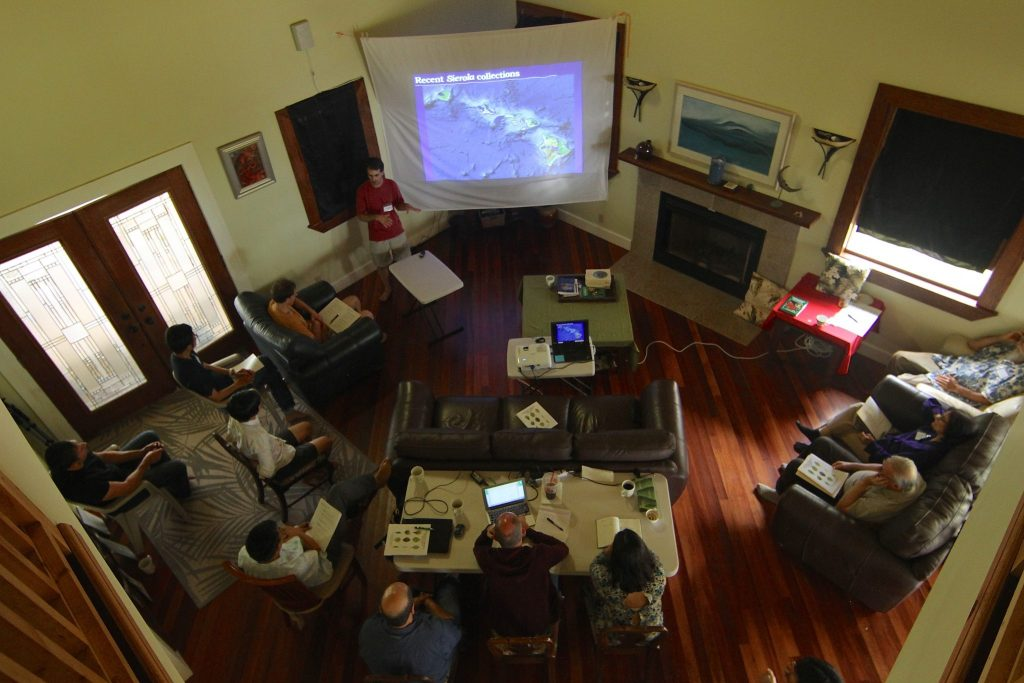 scientists listening to a presentation in the living room