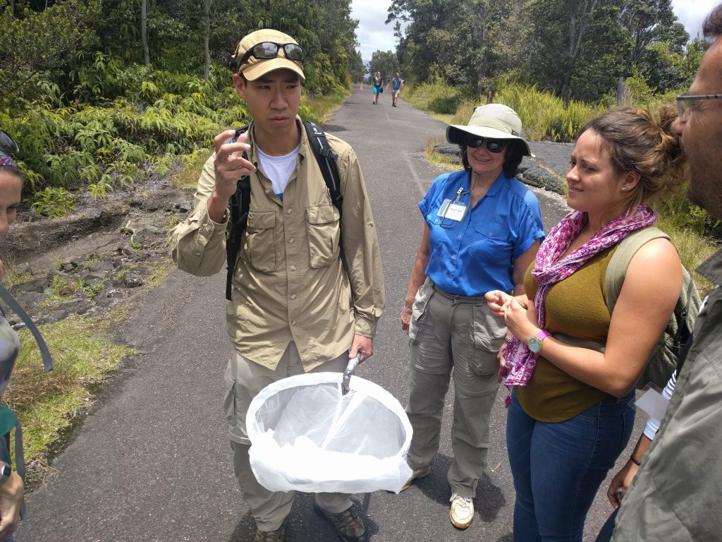 scientists conversing on a trail