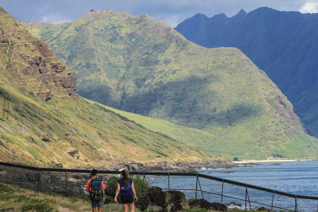 scientists hiking near the coast
