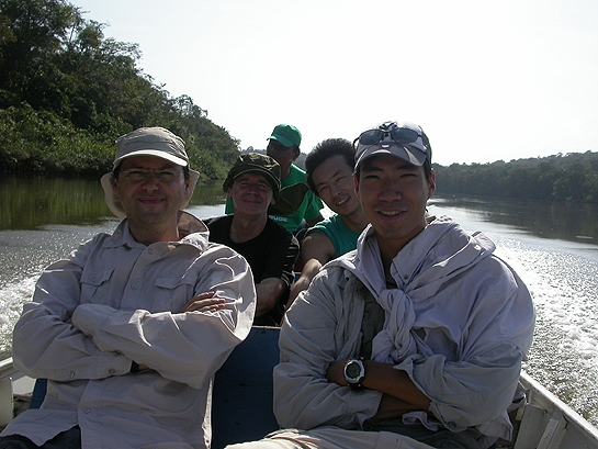 scientists on a boat in French Guiana