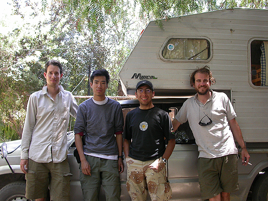 scientists leaning agaist a camper truck