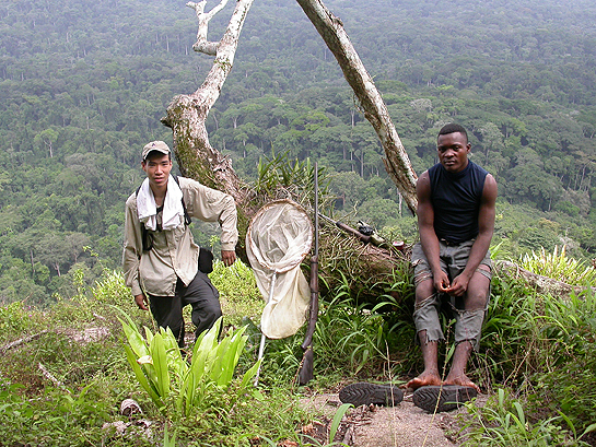 scientists resting on a trek in the Congo