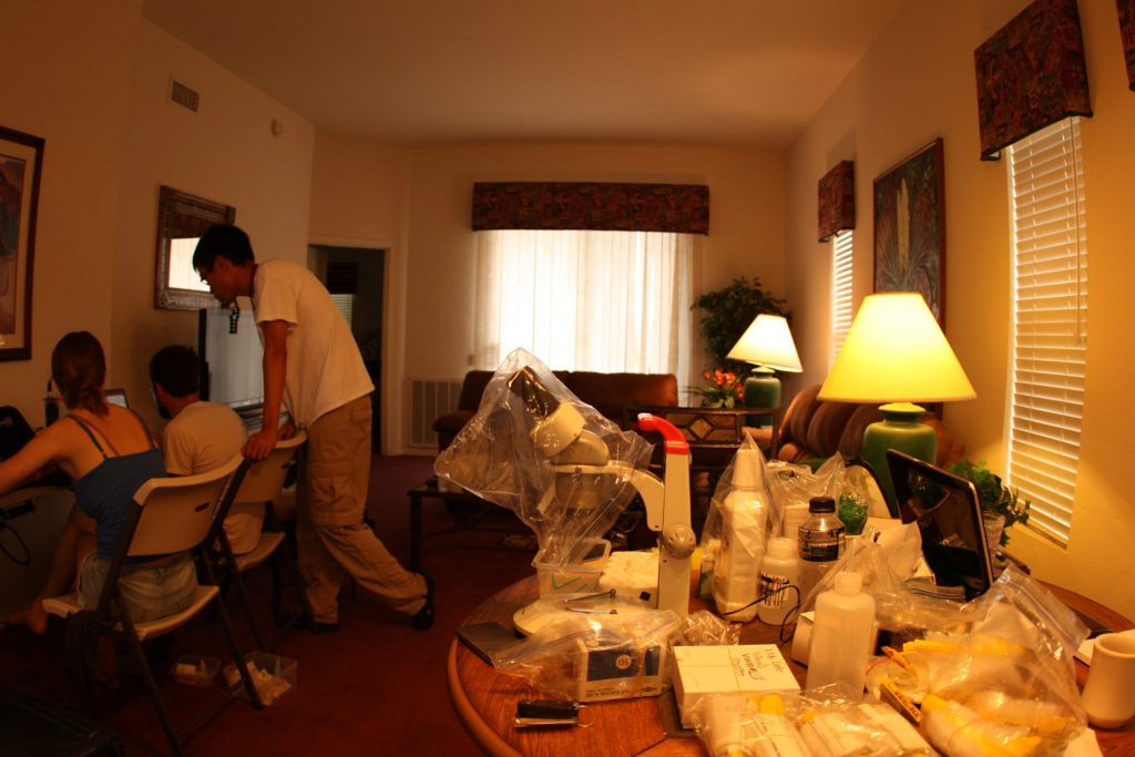 scientists and lab equipment in a hotel room
