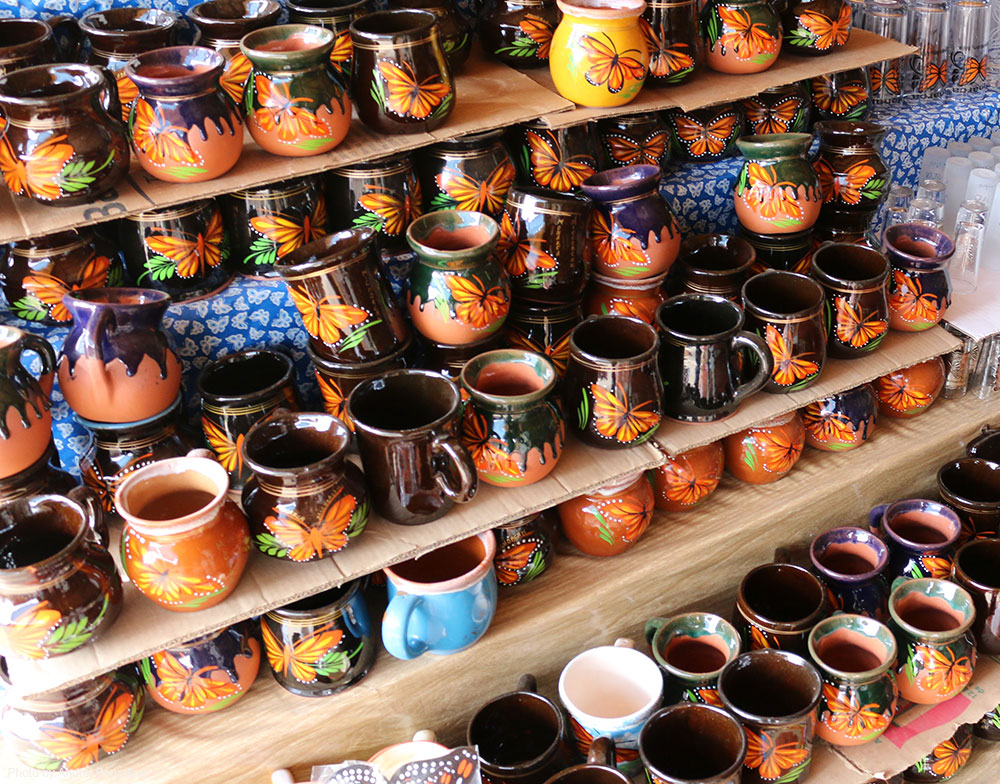Clay pots painted with images of Monarchs.