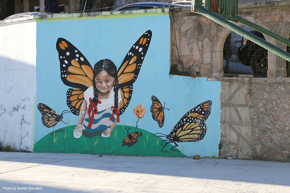 Street art showing young girl with Monarch wings.