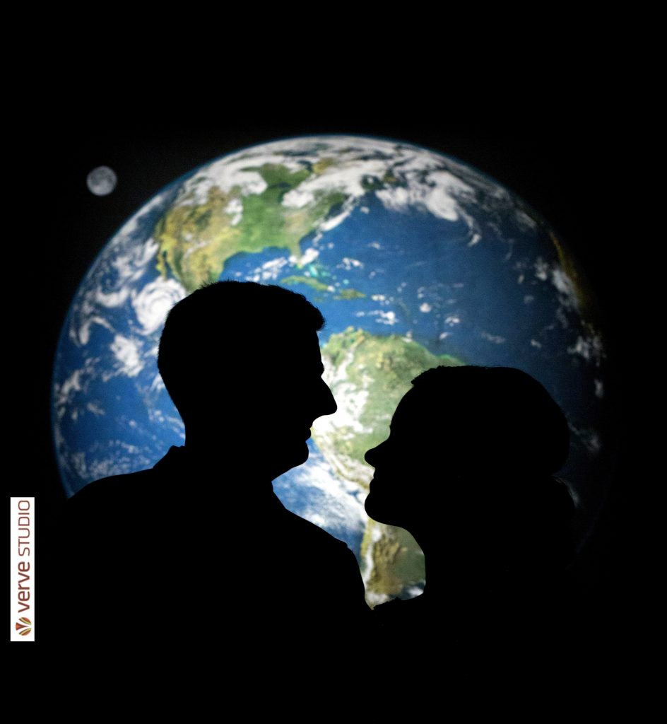Couple silhouette in front of Earth display