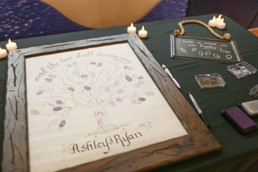 """the bride and groom opted for a """"thumbprint tree"""" in lieu of a guestbook"""