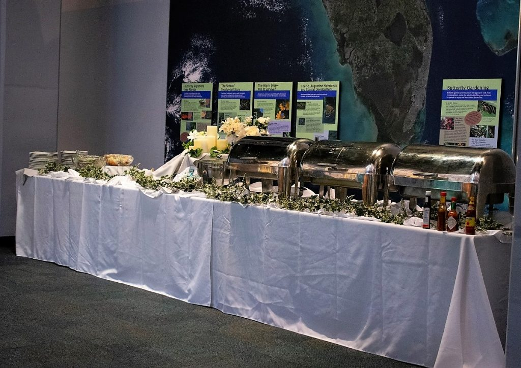 Buffet with chafing dishes in front of map of Florida.