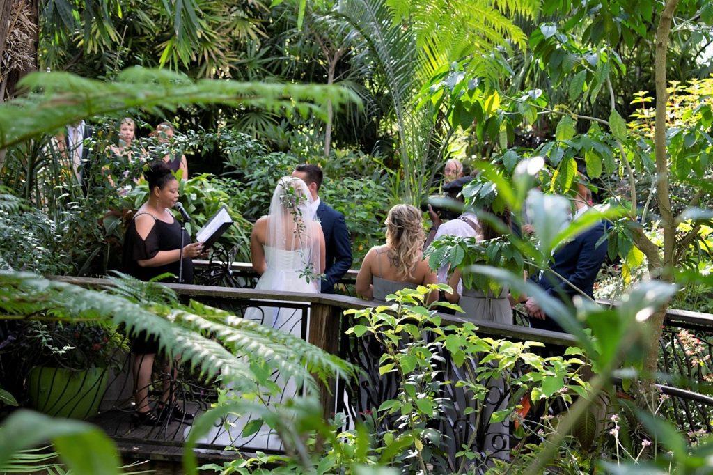 Far-away shot of wedding taking place on bridge.