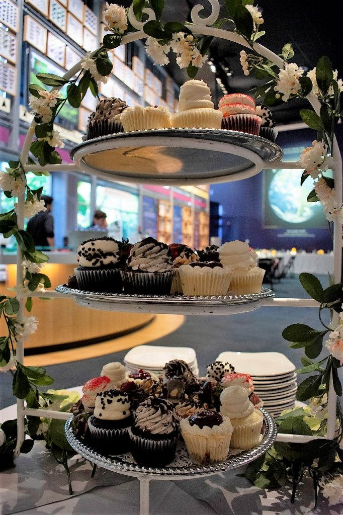 View of Thompson Gallery through a tall rack of cupcakes.