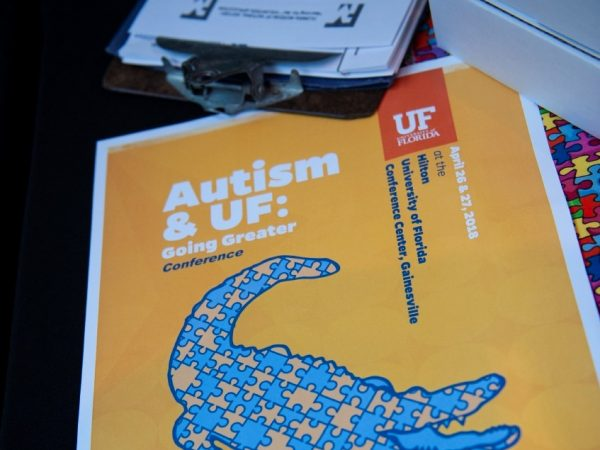 Autism & UF program, yellow with image of gator made of blue and yellow puzzle pieces