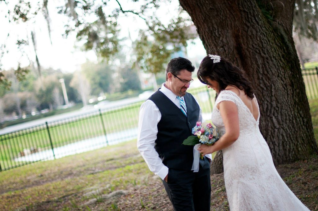bride and groom have a quiet moment during their first look under the museum oak tree