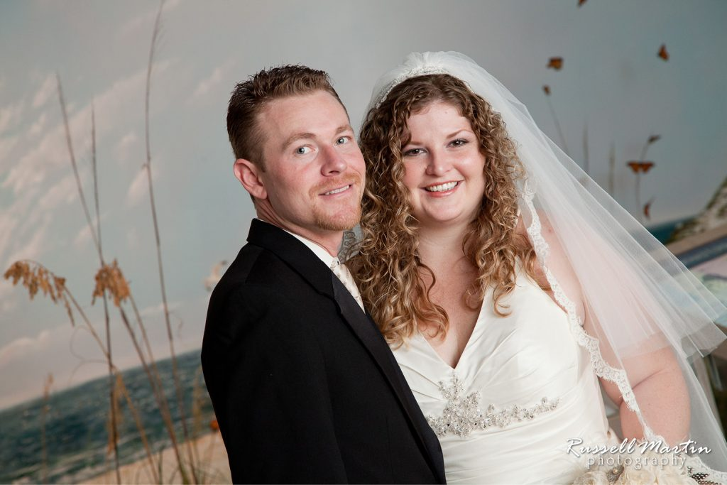 Bride and Groom in Southwest Florida exhibit, posing with beach backdrop.