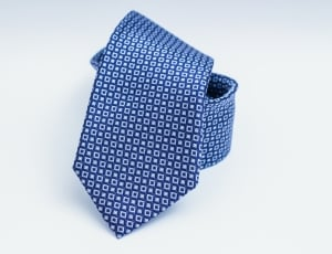 rolled up blue patterened tie