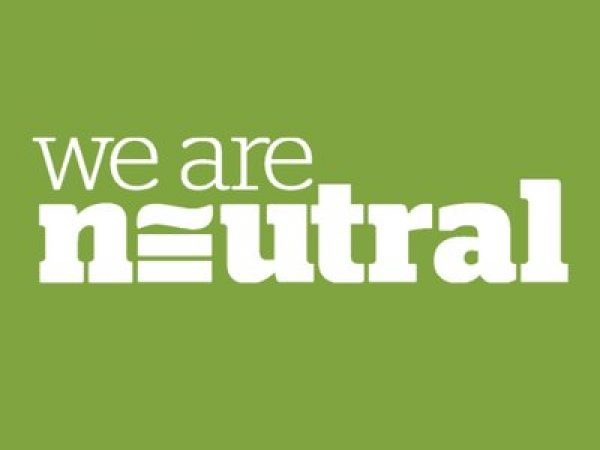 we are neutral text logo on spring green background