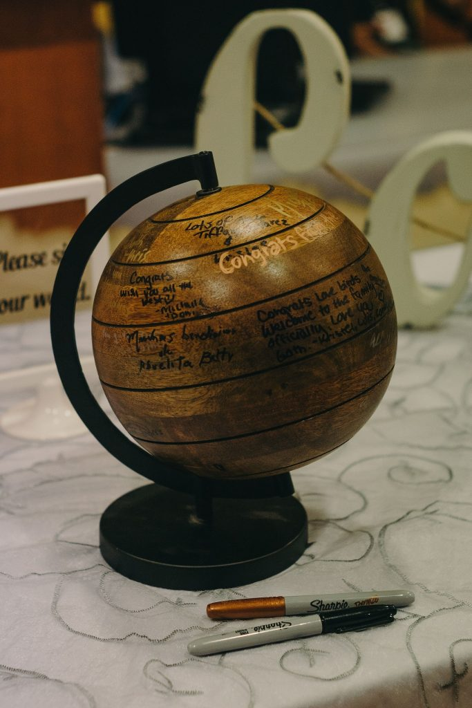wooden globe acting as guestbook