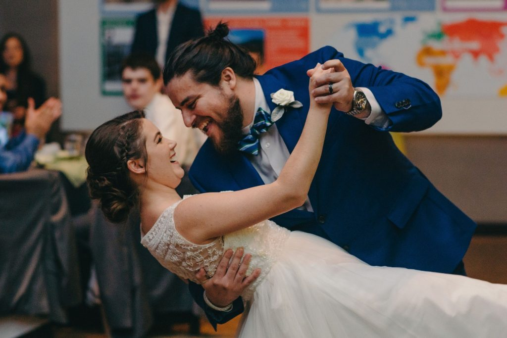 groom dips bride while they dance