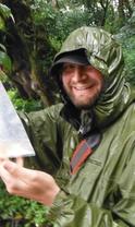 person in a rain coat