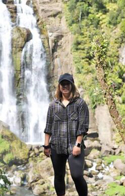 person standing in-front of a waterfall