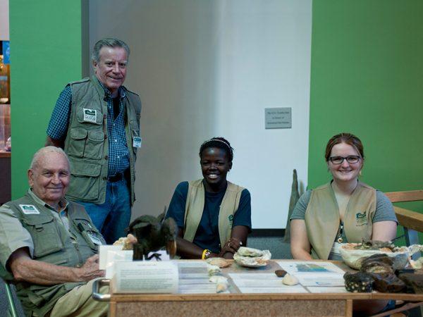 volunteers at table