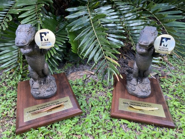 Two trophies for the volunteers of the year. Each trophy is a gator standing on its back legs holding the FM logo.