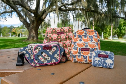 several print bags on a table under a tree
