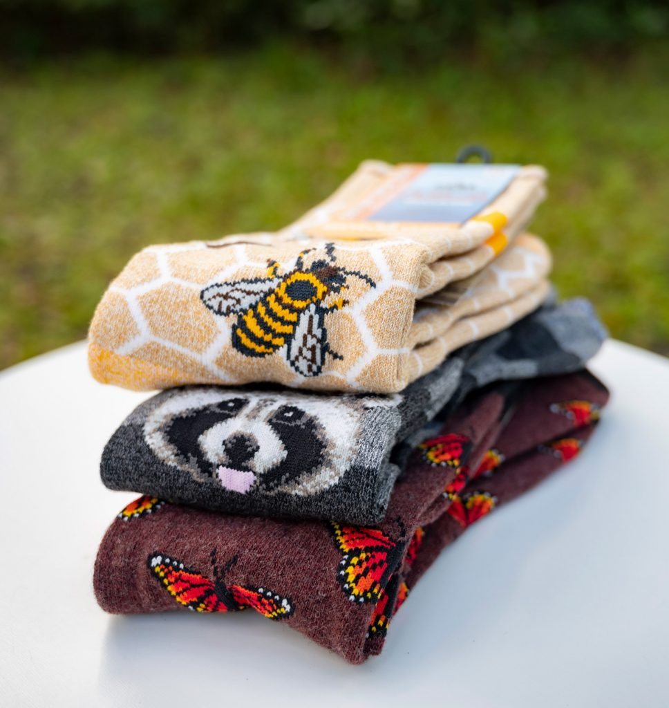 several socks with insect and animal patterns