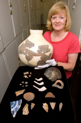 Dr. Deagan with Fort Mose artifacts
