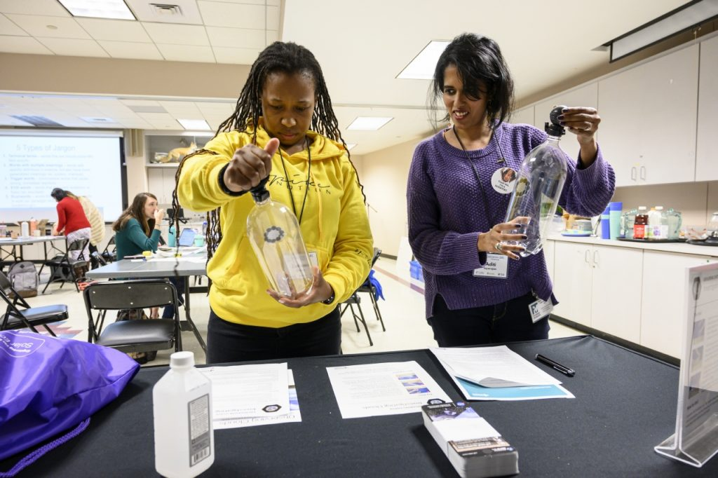 two women doing science activity
