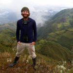 Ian Ausprey standing in a cloud forest in Peru.