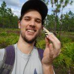 Michael Belitz holding a butterfly.