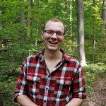 Scott Cinel standing in front of trees.