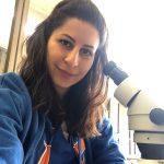 Fatemah Jamal with microscope.