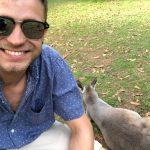 Mitchell Riegler near a kangaroo.