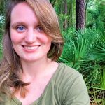 Lauren Whitehurst in front of green foliage