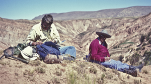 old photo of two researchers on a desert hillside