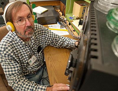 Tom Webber listens to bird recordings