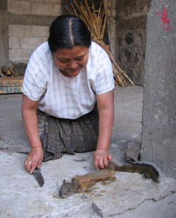 woman skins squirrel