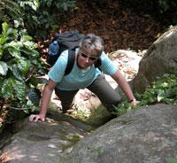 Linda Brown climbing a rock