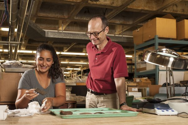 Charles Cobb and student Domenique Sorresso examine Native American pottery sherd